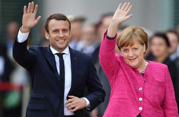 Resultado de imagen para Merkel y Macron piden una globalización más justa en Davos antes de la llegada de Trump