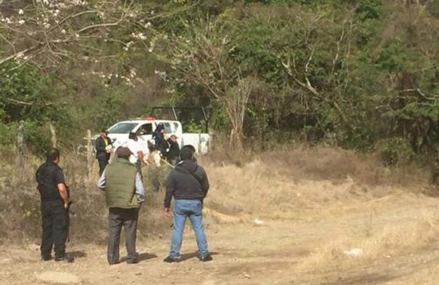 Encuentran cuerpo putrefacto en un predio de Veracruz
