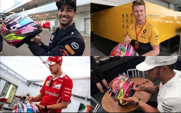 Pilotos de la F1 firman casco de Checo Pérez para subastarlo por México