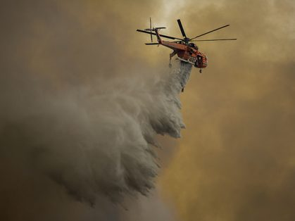 BURBANK, CA - SEPTEMBER 02: An Erickson Air Crane firefighting helicopter drops water over the La Tune Fire on September 2, 2017 near Burbank, California. Los Angeles Mayor Eric Garcetti said at a news conference that officials believe the fire, which is at 5,000 acres and growing, is the largest fire ever in L.A. People have been evacuated from hundreds of homes in Sun Valley, Burbank and Glendale. About 100 Los Angles firefighters are expected to return soon from Texas, where they've been helping survivors from Hurricane Harvey. David McNew/Getty Images/AFP
