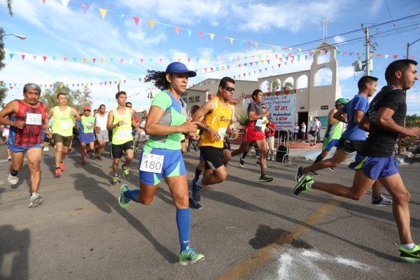 René Alzina y Ángela Izarraraz son los campeones de la carrera 2k del Pilar 2017