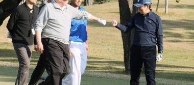 Trump pasa el 'black friday' jugando golf con Tiger Woods y Dustin Johnson