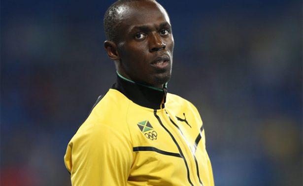 Cava Usain Bolt tumba de su amigo Germaine Mason, muerto en accidente