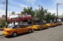 Taxistas lanzarán app y bajarán tarifas para competir contra Uber