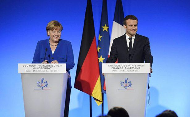 Merkel y Macron contemplan que eurozona tenga un presupuesto propio