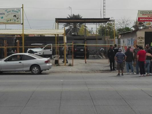 Asesinan a balazos a cliente de lavado de autos