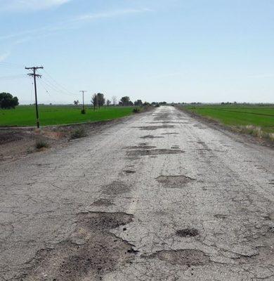 Mal estado carretero impacta al campo