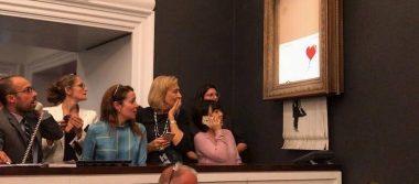 Banksy revela más secretos de su obra maestra de autodestrucción en subasta